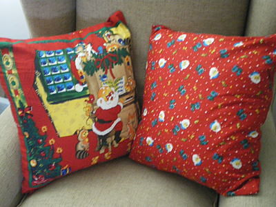 2 X LARGE RED SANTA CUSHIONS WITH INSERTS