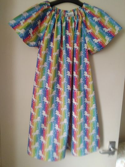 LOVELY GIRLS RAINBOW/UNICORN POCKET DRESS 6-7 YEARS