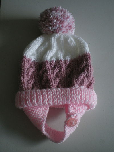 LOVELY GIRLS HAND KNITTED CABLE HAT WITH EAR FLAPS - BIRTH /3 MONTHS